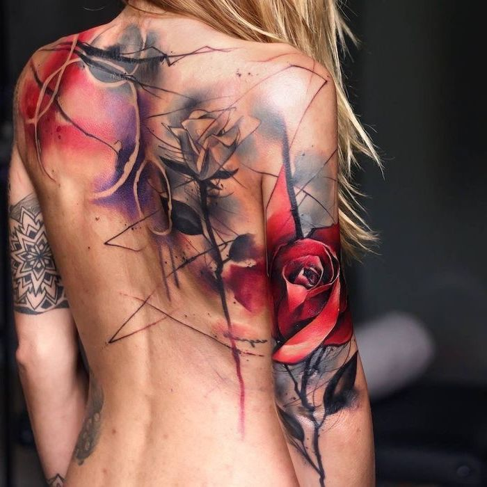 back tattoo on blonde woman trash polka eagle tattoo two roses circles tattoo going across back and back of arm