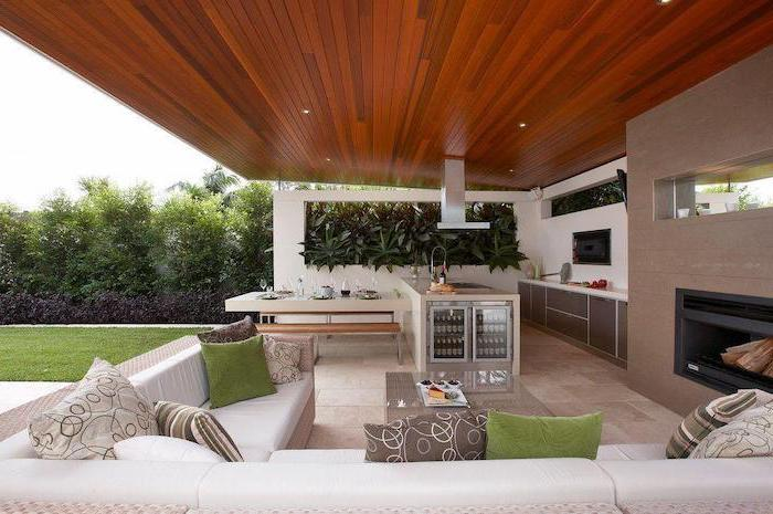 backyard kitchen ideas outdoor lounge area with fireplace large white corner sofa kitchen island with fridge