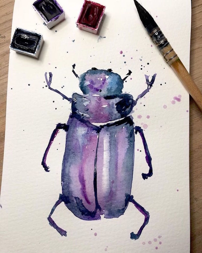 beetle painted in watercolor, watercolor painting for beginners, blue and purple colors used, painted on white background