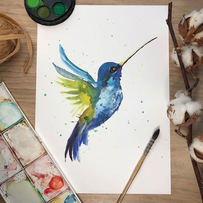 blue hummingbird with green wings, easy watercolor paintings, painted on white background, placed on wooden surface