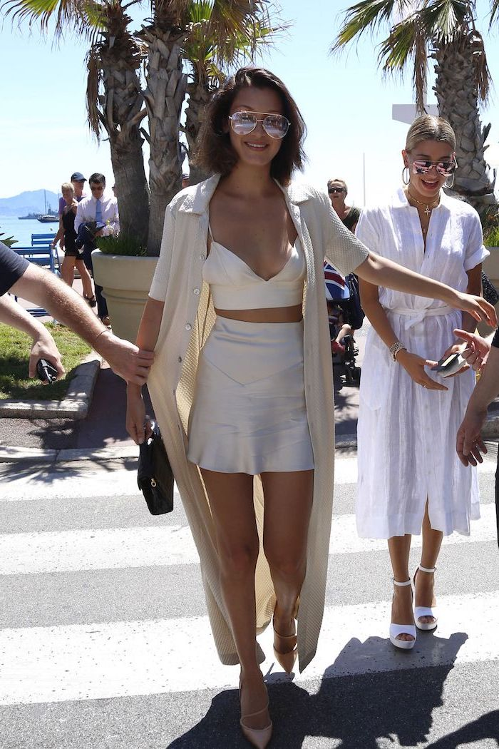 bella hadid and hailey bieber on the street shorts summer outfits wearing white skirt and crop top long kimono