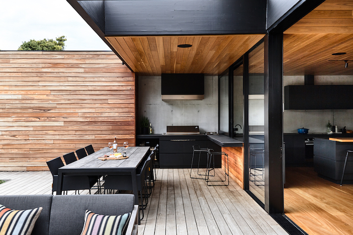 black cabinets and chairs how to build an outdoor kitchen wooden table ceiling and floor black countertops