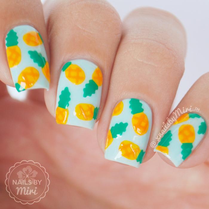 blue nail polish, short square nails, pineapples decorations, nail design ideas