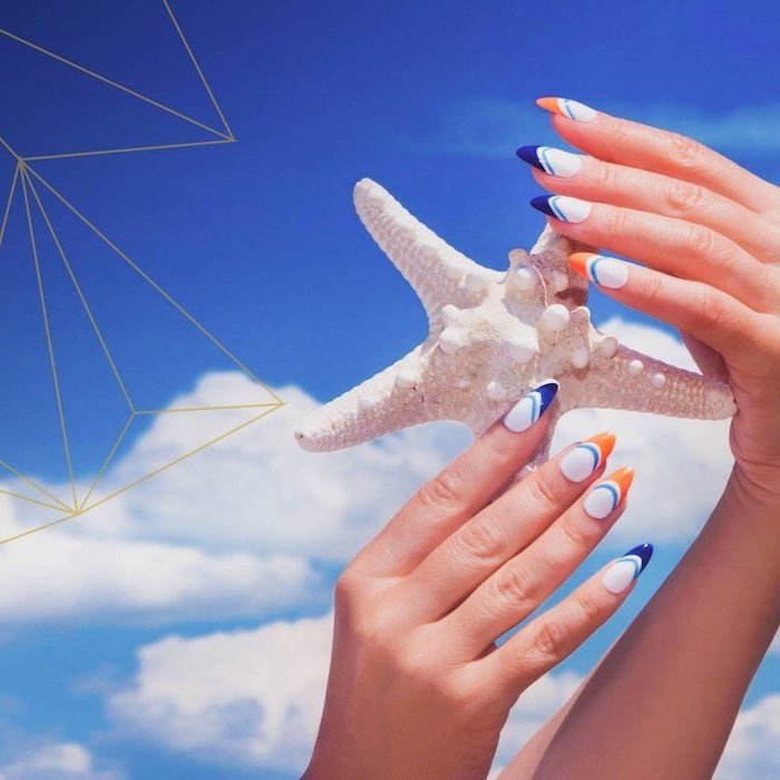 long almond nails, white nail polish, orange and blue french tips, summer acrylic nails, sky in the background
