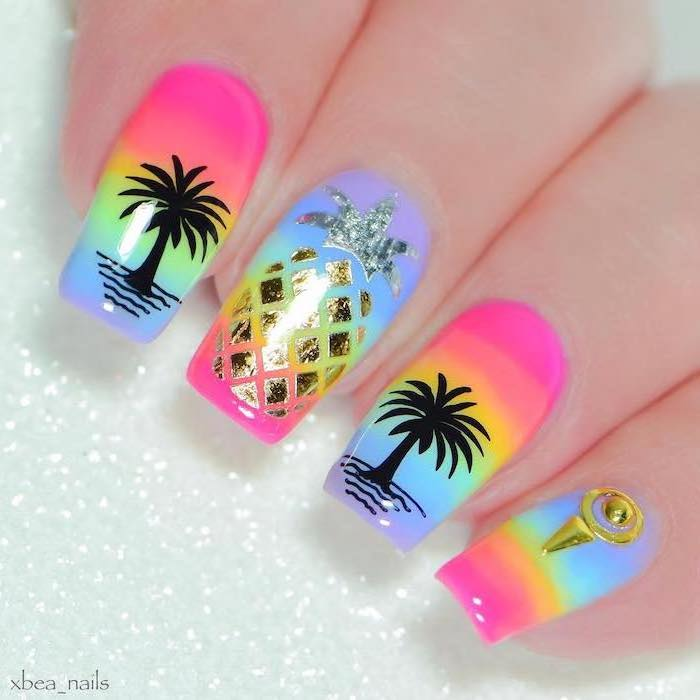 rainbow nail polish, pineapple and palm trees decorations, rhinestones on the pinky, summer nail colors