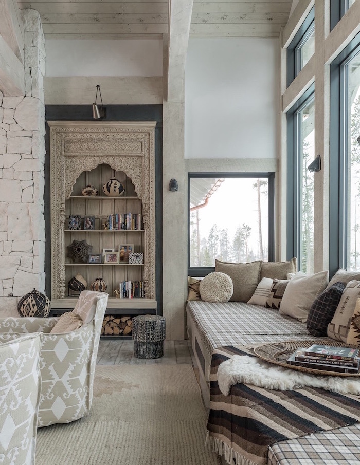 blue window frames, pallet sofa with lots of throw pillows, farmhouse decor, grey armchairs on white carpet