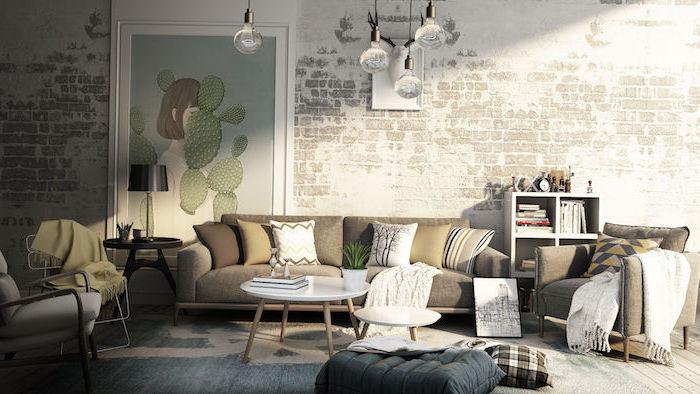 white brick wall, modern farmhouse decor, grey furniture set, small white round coffee tables, art on the wall