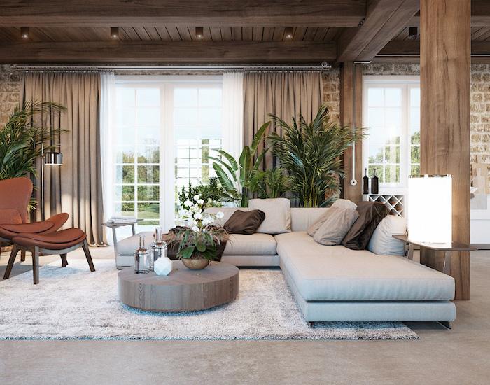 white corner sofa, farmhouse decor ideas, round wooden coffee table, brown leather armchair, white carpet on granite floor