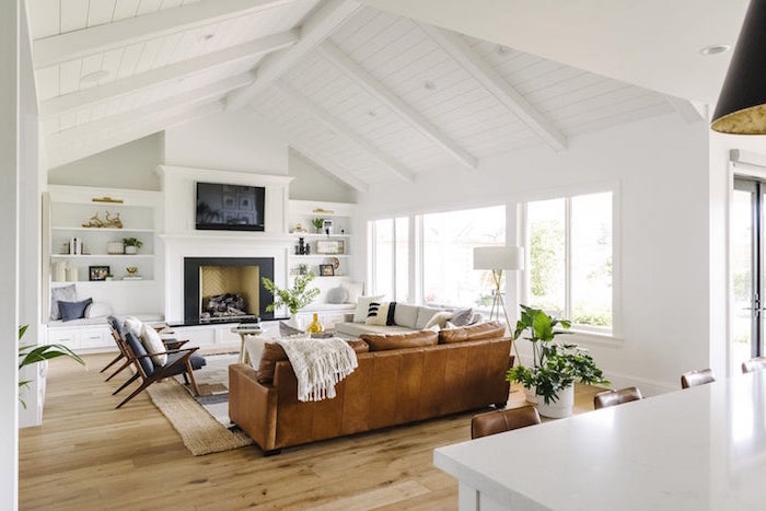 brown leather sofa, black armchairs, white sofa placed in front of a fireplace, farmhouse decor ideas, wooden floor