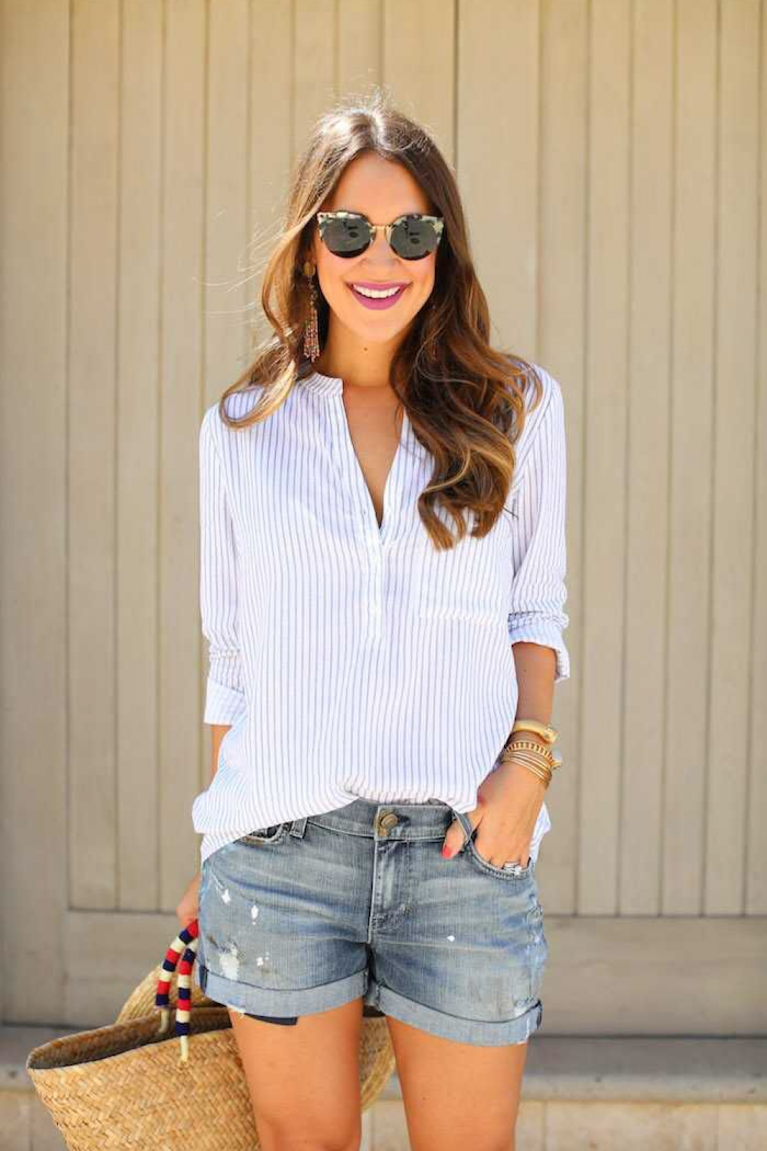 brunette woman wearing jean shorts white shirt cute summer outfits dark sunglasses golden bracelets