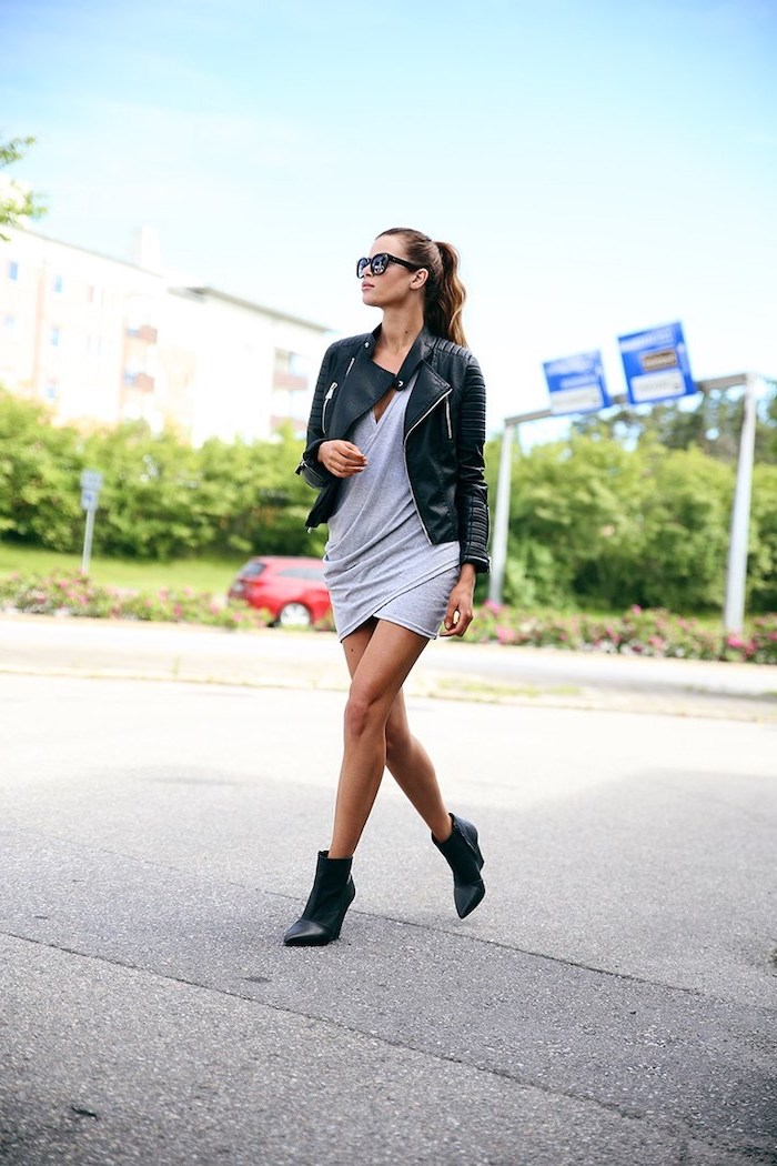 brunette woman with hair in ponytail wearing grey dress with black leather jacket and boots pinterest cute outfits