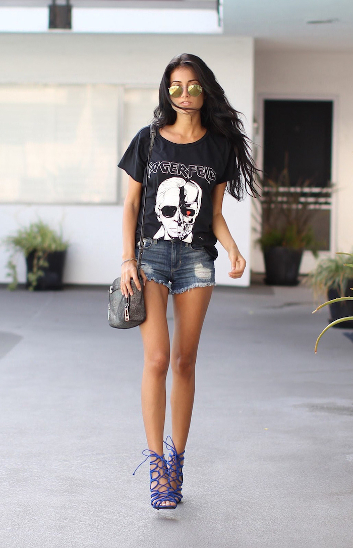 brunette woman with long wavy hair pinterest cute outfits wearing denim shorts black t shirt blue heeled sandals