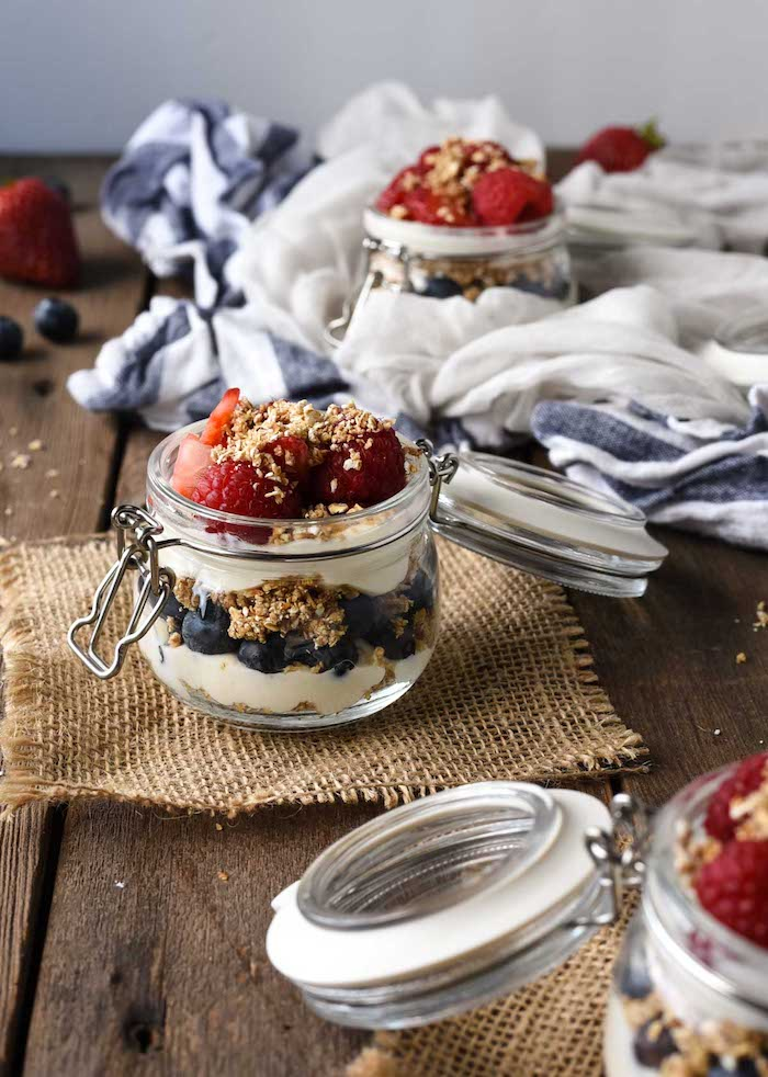cheesecake parfaits made with oatmeal blueberries and strawberries no bake dessert recipes layered in glass jars