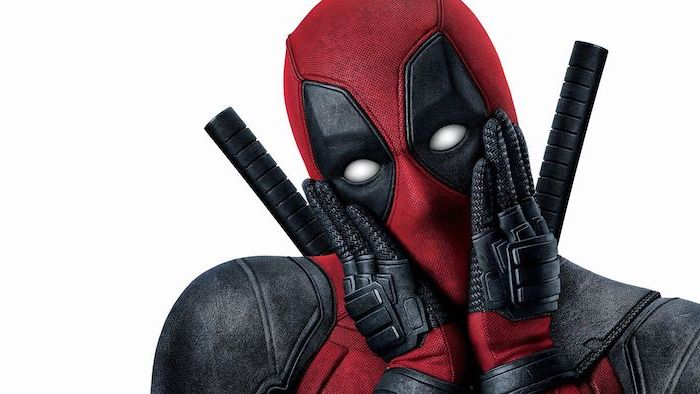 close up photo of deadpool in full costume holding his face on white background funny wallpapers