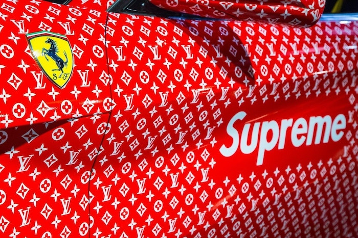 close up photo of ferrari covered in louis vuitton supreme logos cool wallpapers supreme ferrari emblem