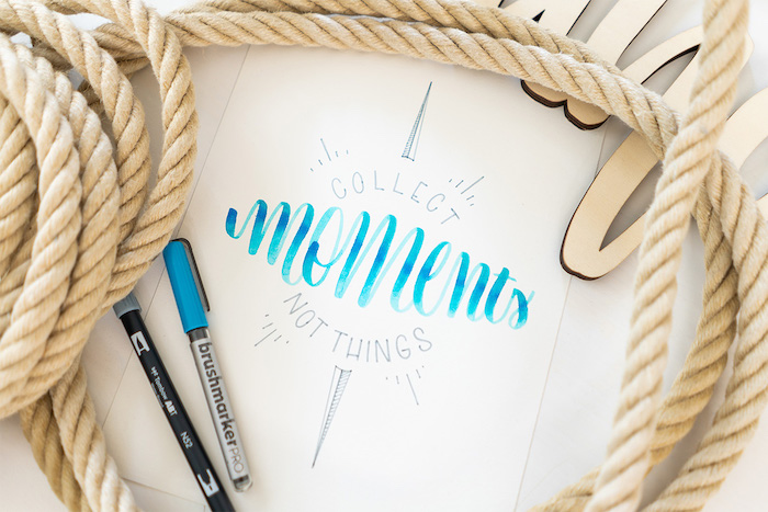 collect moments not things written with blue and black letters on white background hand lettering different fonts