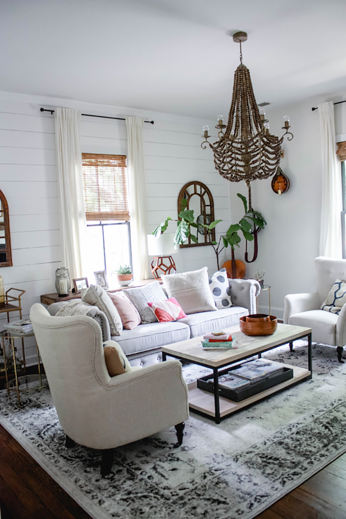 white furniture set, sofa with two armchairs, wooden coffee table, rustic home decor, white carpet on wooden floor