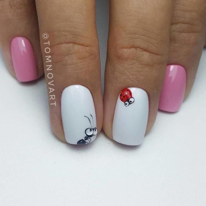 white and pink nail polish, ladybug decorations, cute nail colors, short squoval nails, white background