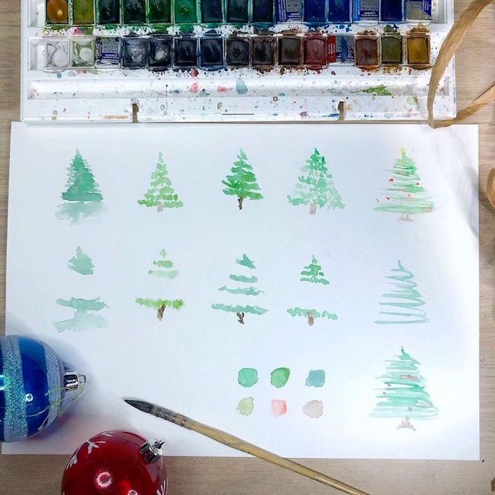 christmas trees, drawn in different ways, watercolor landscape painting, green watercolor trees on white background