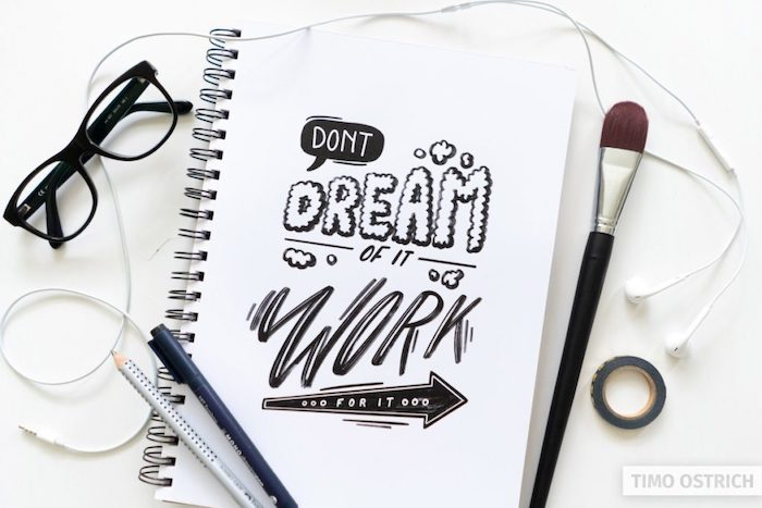 dont dream of it work for it written with black letters in different fonts hand lettering white background