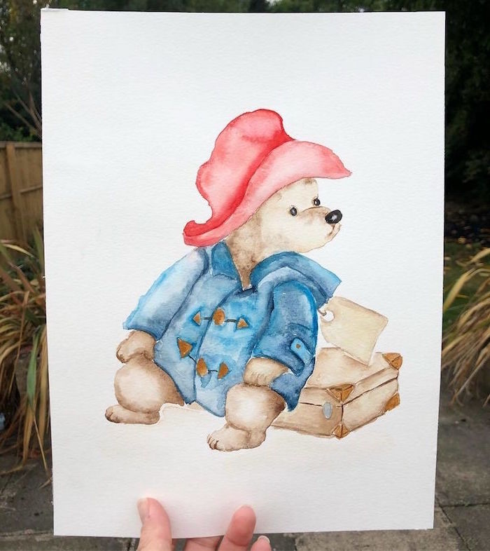 painting of paddington, sitting on his suitcase, beginner easy painting ideas, wearing blue coat and red hat