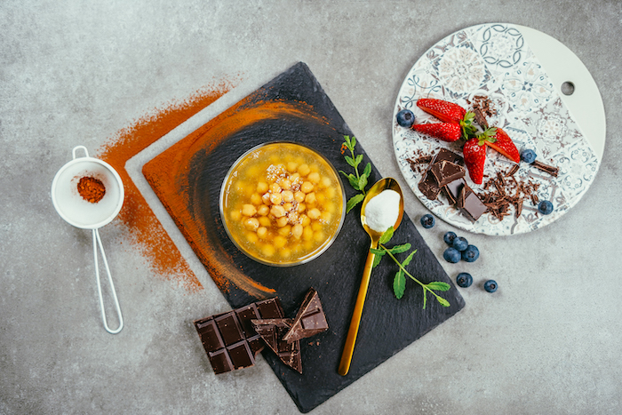 easy dessert recipes no baking bowl of chickpeas chocolate cocoa blueberries strawberries ingredients arranged on grey surface