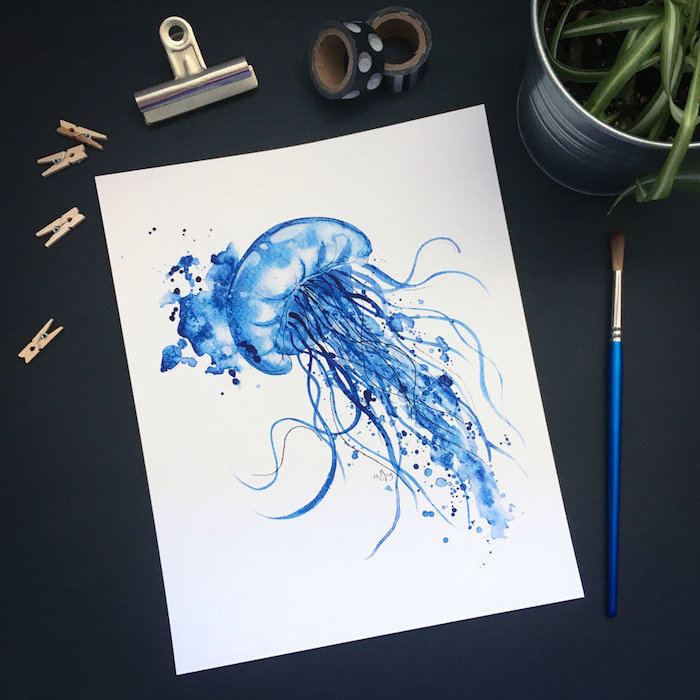 blue jellyfish, drawn in watercolor on white background, easy paintings for beginners, placed on black surface
