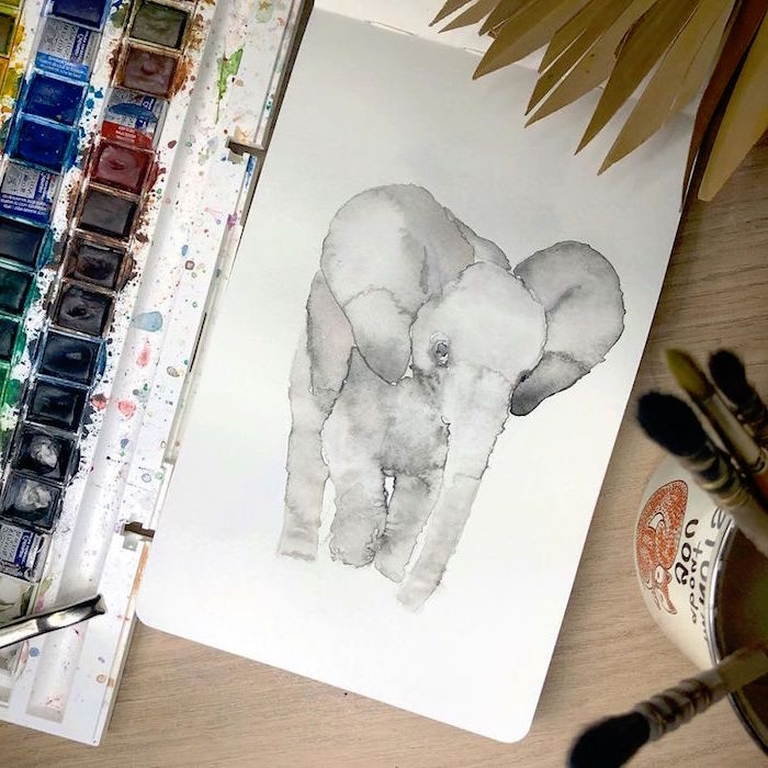 painting of an elephant, easy watercolor flowers, painted on white background, placed on wooden surface