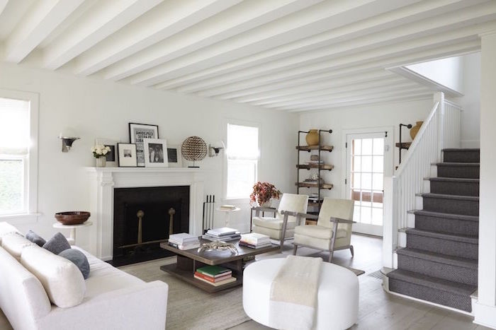white furniture set, wooden coffee table, placed in front of a fireplace, farmhouse living room ideas