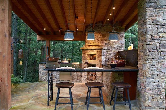fireplace with barbecue grill outdoor kitchen ideas stone columns and floor marble countertop with three bar stools