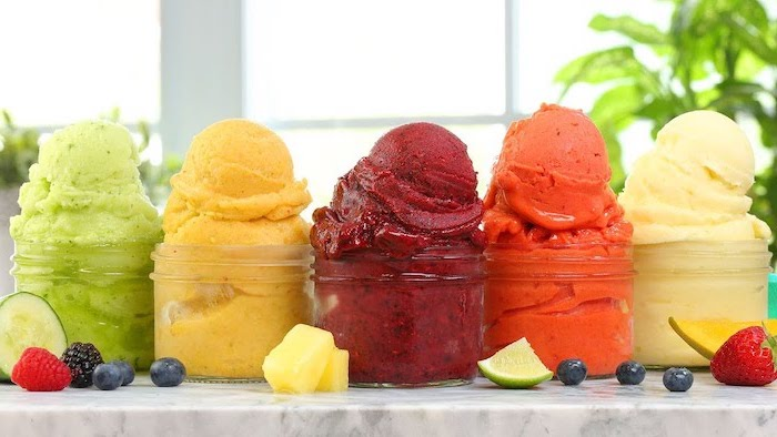 five different sorbet flavors inside glass jars easy no bake desserts raspberries blueberries strawberries black berries pineapple lime