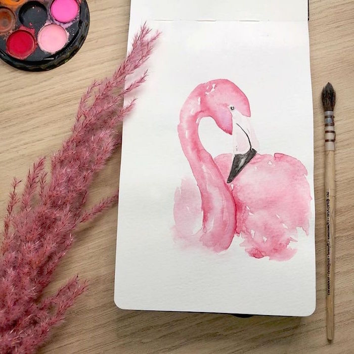 painting of a flamingo, painted in pink, easy watercolor flowers, painted on white background, placed on wooden surface