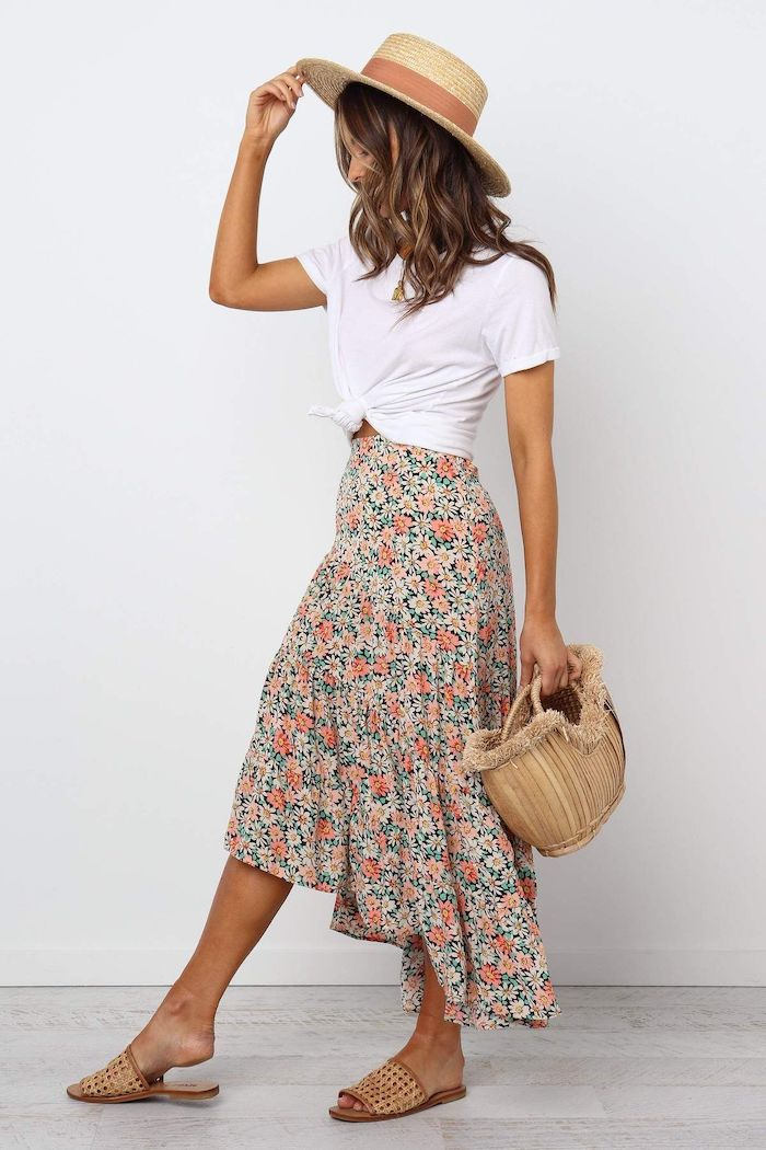 floral skirt white t shirt worn by brunette woman summer outfits brown hat and sandals bamboo bag