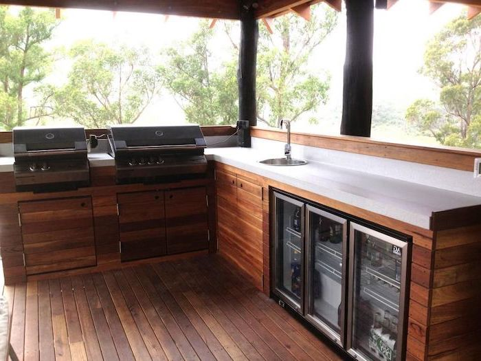 fridge and two grills with wooden cabinets how to build an outdoor kitchen granite countertops with small sink