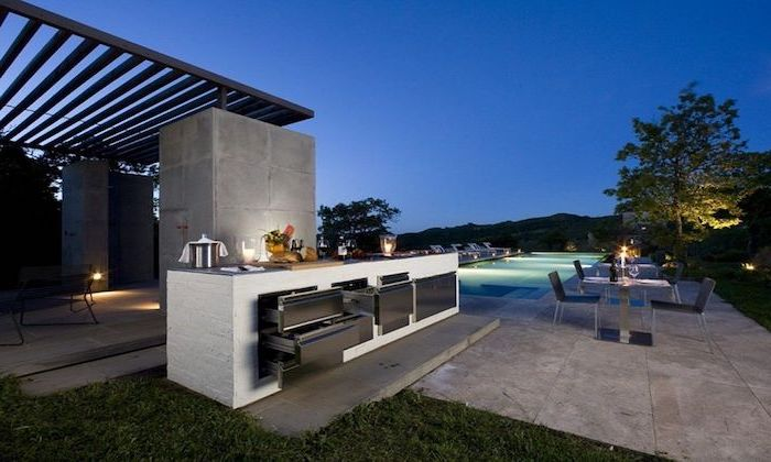 glass dining table with chairs next to a pool outdoor grill ideas white kitchen island with cabinets on stone tiled floor