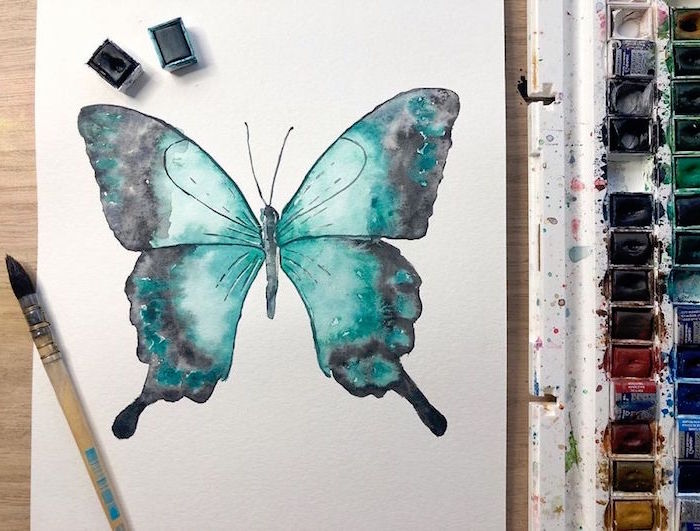 painting of a butterfly, painted with green and black watercolor, easy watercolor painting ideas, white background