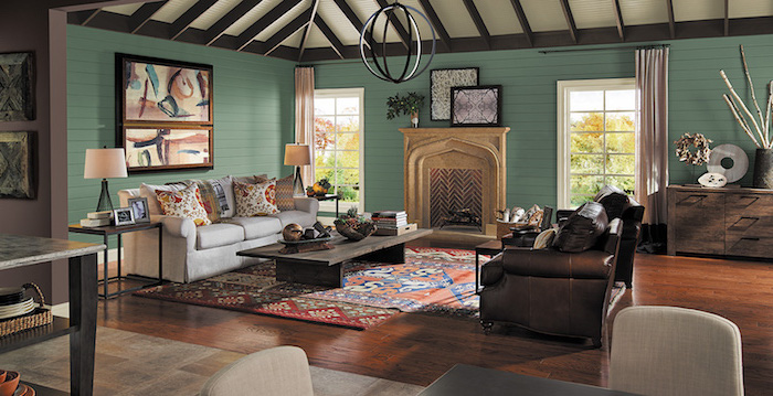 green wooden walls, rustic farmhouse decor, colorful carpet on wooden floor, brown leather sofa, wooden coffee table