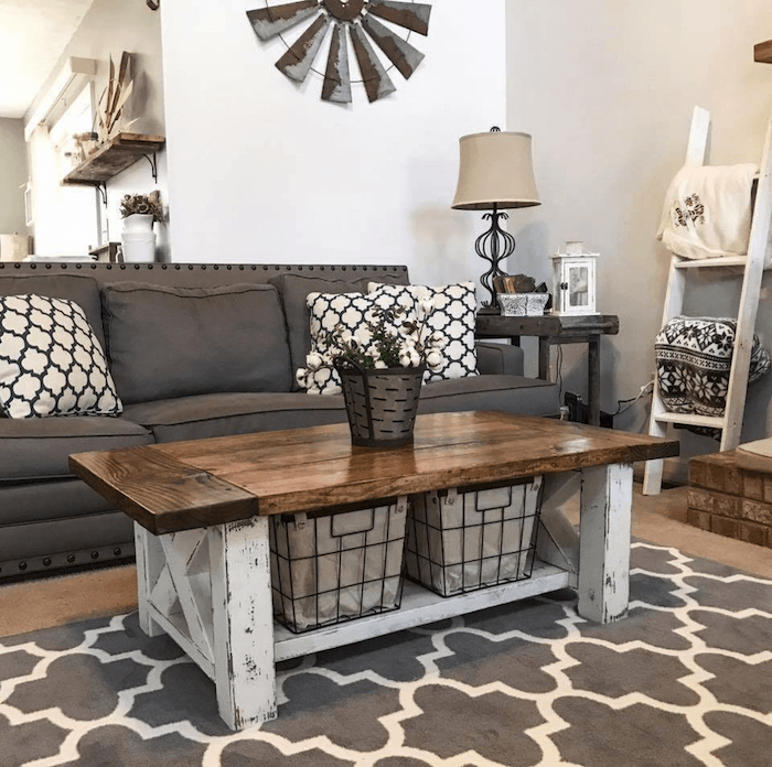 grey sofa with black and white throw pillows, wooden coffee table, farmhouse style homes, grey carpet on wooden floor