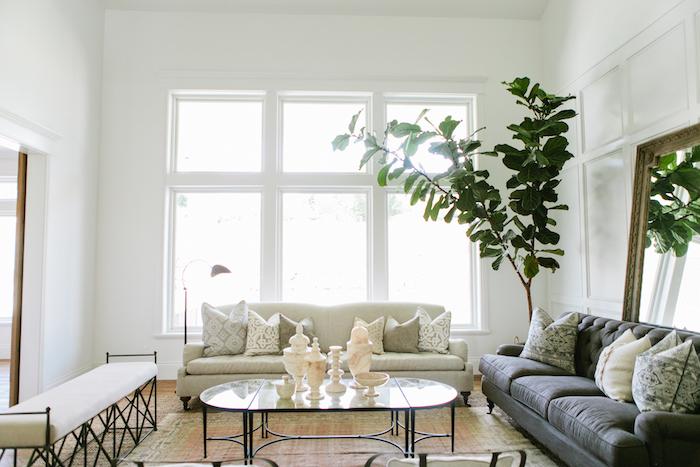 grey and white sofas, white ottoman, farmhouse style homes, glass coffee table, white walls