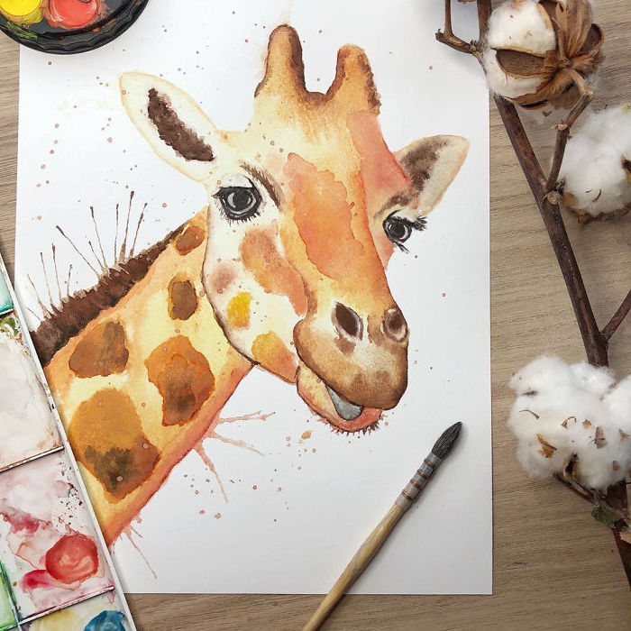 painting of a giraffe's head, painted on white background, watercolor painting ideas, placed on wooden surface