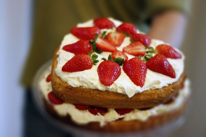 heart shaped victoria sponge cake summer dessert recipes with white buttercream and strawberries on top