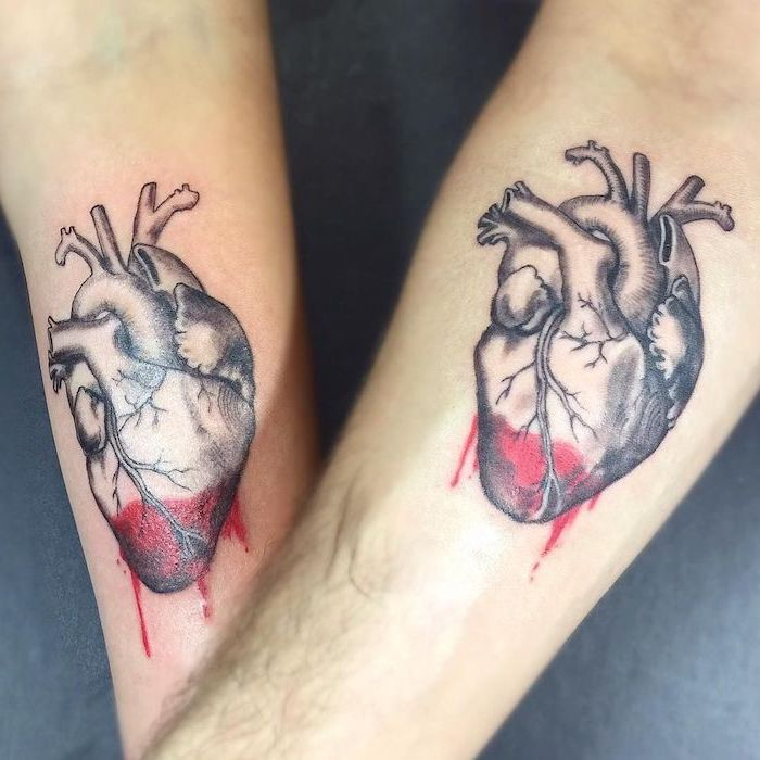 hearts in black and red sibling tattoos for 3 matching forearm tattoos grey background