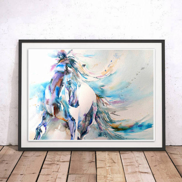 drawing of a horse, painted in different colors, inside black frame, easy watercolor ideas, white wall