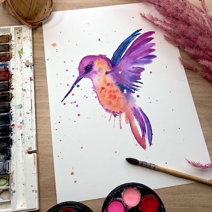 painting of a hummingbird, painted in purple and orange, how to use watercolor paint, painted on white background