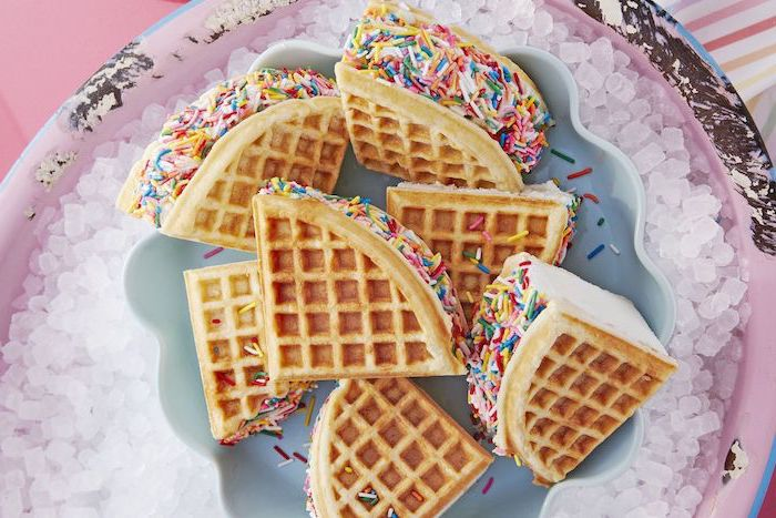 ice cream sandwiches made with waffles and sprinkles on top easy summer desserts arranged on plate placed on ice