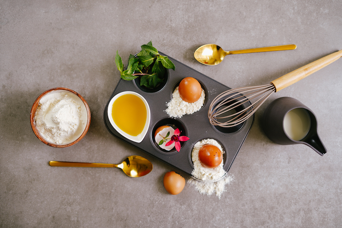 ingredients for yorkshire pudding arranged on grey surface summer desserts for parties flour eggs oil milk