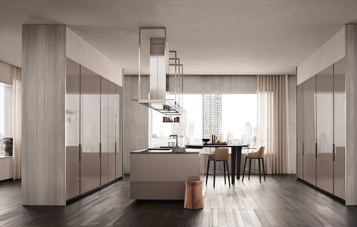 kitchen in beige, modern kitchen, white kitchen island, black dining table with bar stools, wooden floor