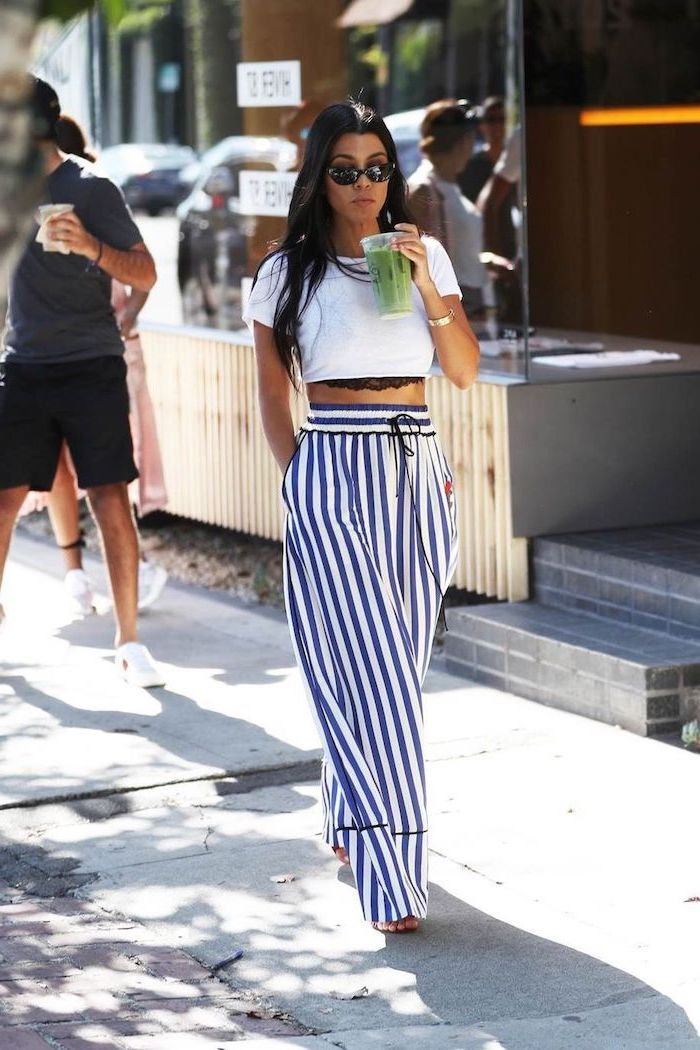 kourtney kardashian wearing blue and white striped wide fit trousers white crop top cute casual outfits