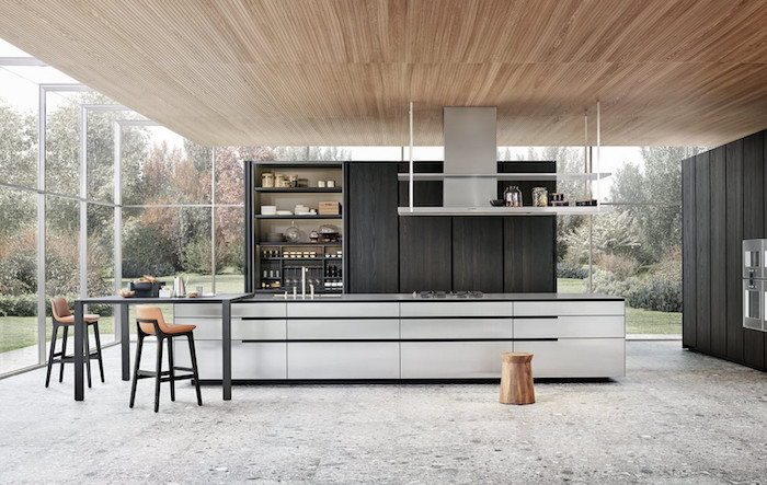 long kitchen island in black and white, tall black bar stools, modern kitchen, dark wooden cabinets, open shelving, granite floor