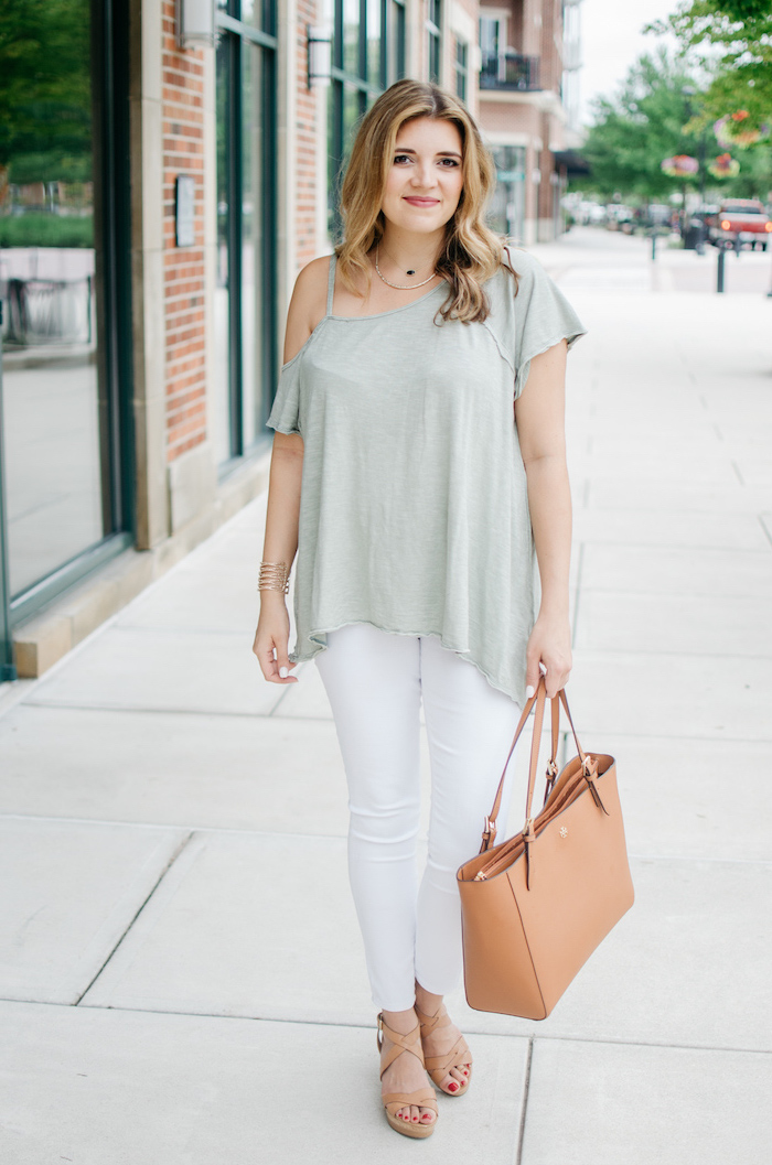 light green top white jeans worn by blonde woman cute simple outfits brown leather bag and sandals